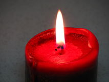 Candle. Burning Bright Red Scented Candle Royalty Free Stock Photo