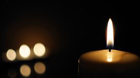 Candle. Burning on a black background Royalty Free Stock Images
