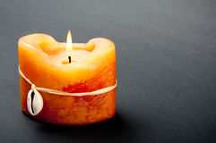 Candle. Close up of a candle on gray background Royalty Free Stock Image