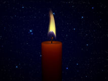 Candle. Red candle under the stars Royalty Free Stock Image