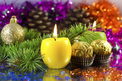 Candle. Nice golden Christmas decorations, sweets and candles Royalty Free Stock Photo