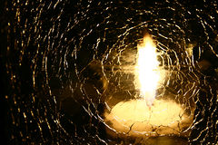 Candle. Light reflection through shattered glass stock photos
