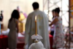 The candle. A candle lit in the Church Stock Photography