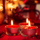 Candle. 3 candle over red background Royalty Free Stock Image