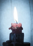 Candle. Burning candle on a blue background Royalty Free Stock Image
