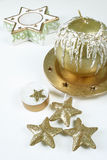 Candle. Gold apple and chrismas star candles Royalty Free Stock Images