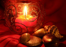 Candle. Red star and seashells and stones Royalty Free Stock Photography