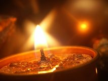 Candle. Warm Candle's Light and Glass Ball in background Royalty Free Stock Image