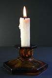 Candle. In black Royalty Free Stock Photos