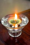 Candle. A candle in the glass on the table Stock Image
