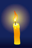 Candle. Burning candle on a dark dark blue background Stock Photo