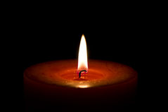 Candle. Red candle isolated on a black stock photos
