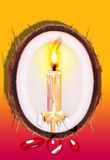 Candle. A brightness candle around the inside of coconut in red and yellow gradient background Royalty Free Stock Images