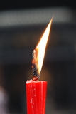 Candle. The combustion red candle, has the bright flame Stock Images