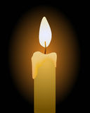Candle. A bright candle around black background Stock Images