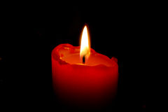 Candle. Red candle on black background Royalty Free Stock Image