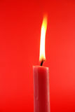 Candle. Shiny fire flame candle on matched background Royalty Free Stock Photography