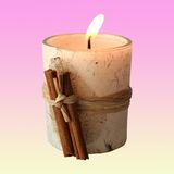 Candle. Cinnamon candle royalty free stock image