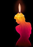 Candle. There is a silhouette of the girl in the form of a burning candle Stock Photos