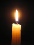 Candle Against Dark Background Stock Photography