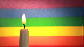 Candle against rainbow flag stock footage