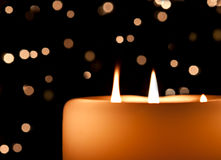Candle aglow Royalty Free Stock Image