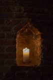 Candle in alcove Stock Photo