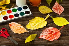 Free Candle And Watercolor Paint To Create Autumn Leaves Royalty Free Stock Image - 191786756