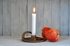 Candle and apples Stock Photography