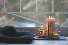 Candle and aroma stick on windowsill. Concept of relax, tranquil, peaceful, unplug, balanced time, Keep kalm and take it easy,