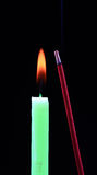 Candle and aromatic stick. Isolated on black background Stock Photography
