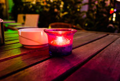 Candle And Ashtray On Wooden Table Stock Photos