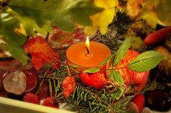 Candle and Autumnal foliage Royalty Free Stock Photography
