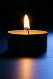 Candle with back lit. Vertical composition. Royalty Free Stock Photo
