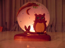 Candle back Owl. A nice candlestick with owl decoration Royalty Free Stock Photo