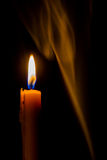 Candle on the background with smoke Royalty Free Stock Images