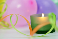 Candle and Balloons Stock Photo