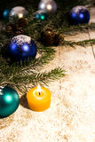 Candle and balls on a christmas background Royalty Free Stock Photos
