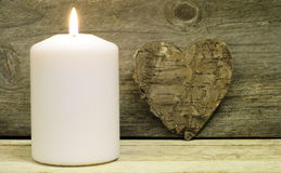 Candle and bark heart Stock Photos