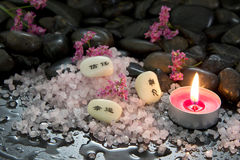 Candle, bath salt and stones - spa arrangement Royalty Free Stock Image