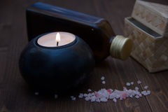 Candle with bath salts and oil on wood Stock Images