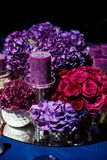 Candle and beautiful flowers on the wedding table.  Stock Photo