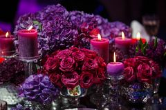 Candle and beautiful flowers on the wedding table.  Royalty Free Stock Photo