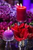 Candle and beautiful flowers on the wedding table.  Royalty Free Stock Images