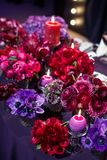 Candle and beautiful flowers on the wedding table.  Stock Image