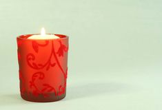 Candle in  beautiful red candlestick. Stock Photo