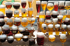 Candle beer glasses Stock Images