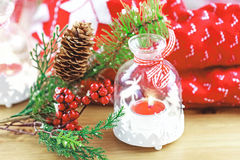 Candle and berries on pine brunch with christmas Stock Photography