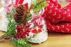 Candle and berries on pine brunch with christmas Royalty Free Stock Images