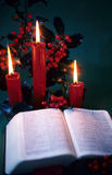 Candle Bible 2. A bible is lit by three candles and other chirstmas decorations Royalty Free Stock Photos